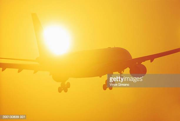 Commercial aircraft on final approach, silhouette