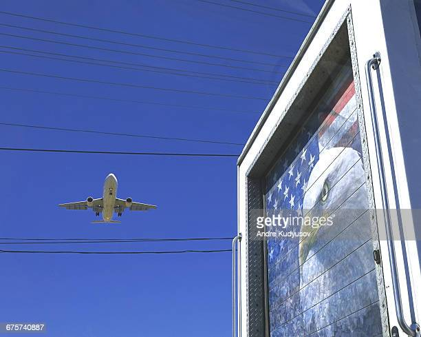 Commercial airliner and semi trailer