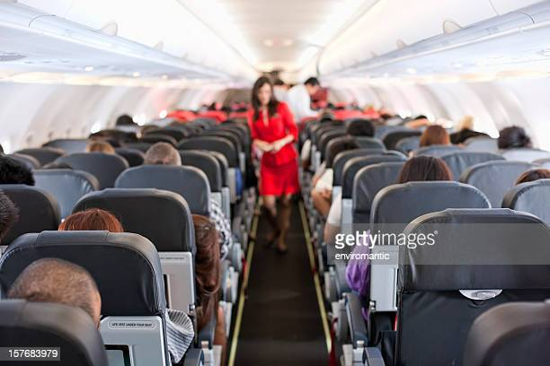 commercial airliner cabin. - aeroplane stock photos and pictures