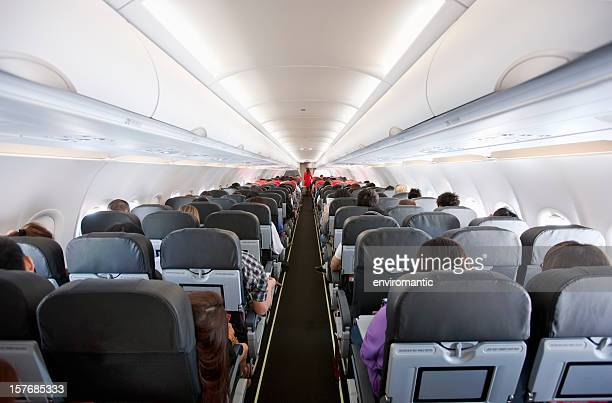 commercial airliner cabin. - vehicle interior stock pictures, royalty-free photos & images