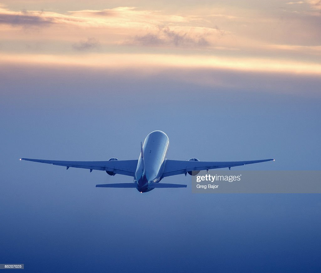 Commercial airliner in flight : Stock Photo
