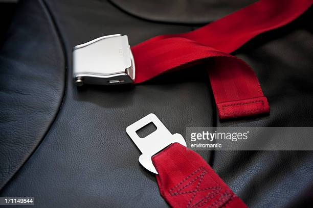 commercial airliner seat belt. - red belt stock photos and pictures
