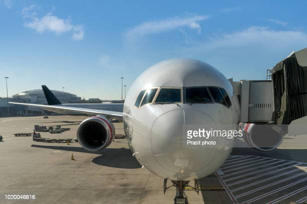 commercial airplane parking at the international airport waiting for boarding. - fuselage stock photos and pictures