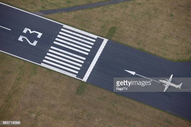 a commercial airplane siting on runway ready for take off. - taxiing stock pictures, royalty-free photos & images
