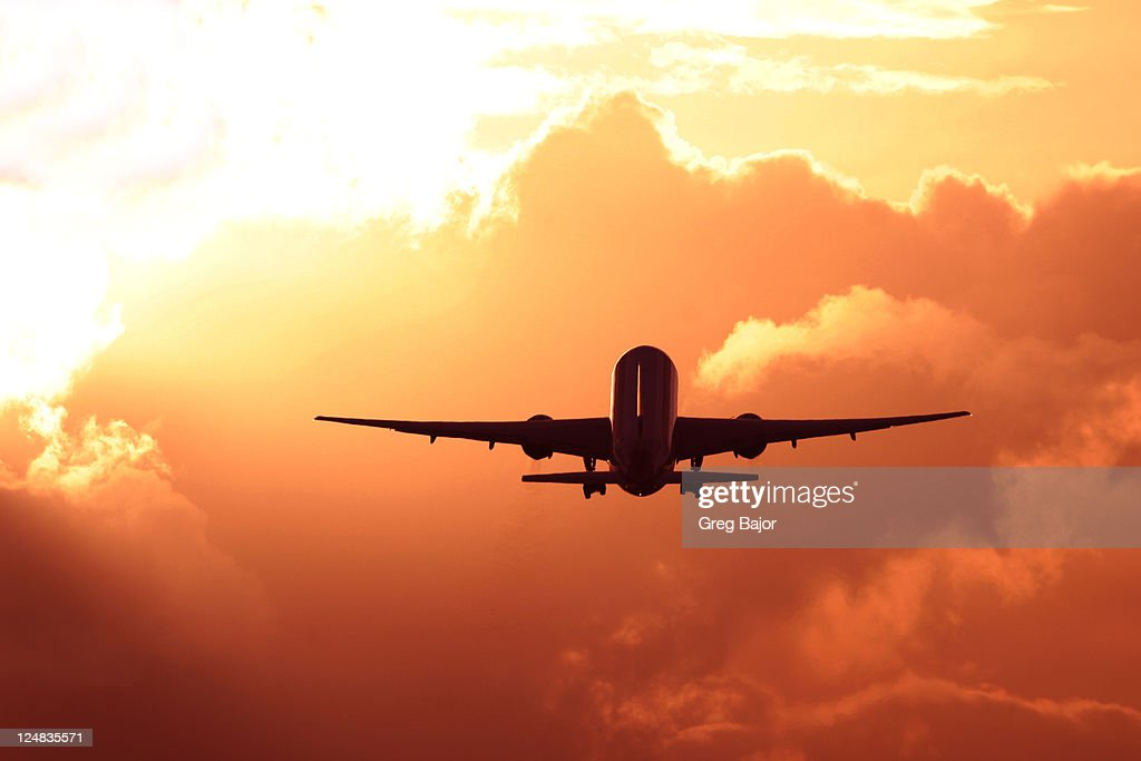 Commercial airplane taking off at dusk : Stock Photo