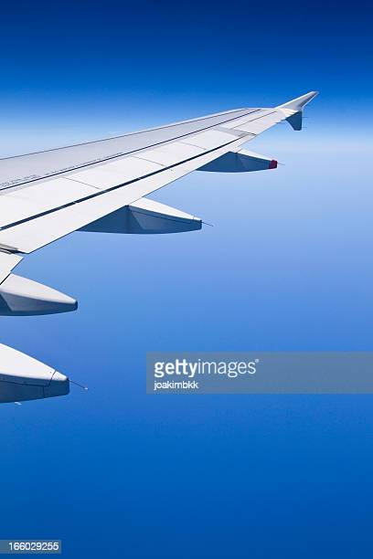 commercial airplane wing at high altitude - fuselage stock photos and pictures