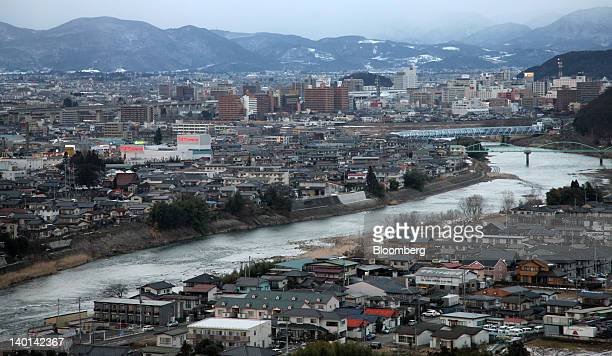 Commercial and residential buildings are seen in Fukushima City Fukushima Prefecture Japan on Friday Feb 10 2012 While Tokyo's annual gross domestic...