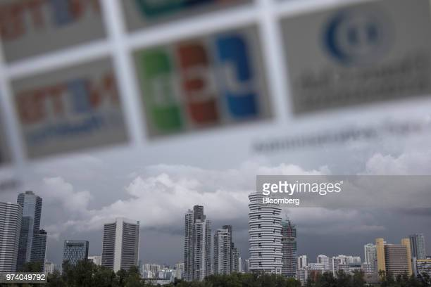 Commercial and residential buildings seen through a window stand in Singapore on Wednesday June 13 2018 Tourism as well as the consumer sector will...