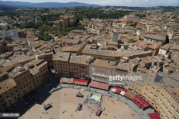 Commercial and residential buildings stand around the Piazza del Campo seen from the Torre del Mangia in Siena Italy on Friday Aug 5 2016 Banca Monte...