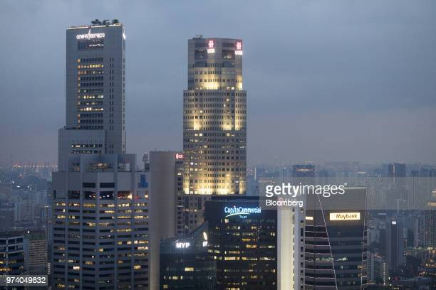 Commercial and residential buildings stand illuminated at dusk in Singapore on Wednesday June 13 2018 Tourism as well as the consumer sector will...
