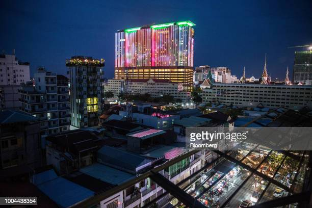 Commercial and residential buildings stand illuminated at night in Phnom Penh, Cambodia, on Sunday, July 22, 2018. Asias longest-serving Prime...