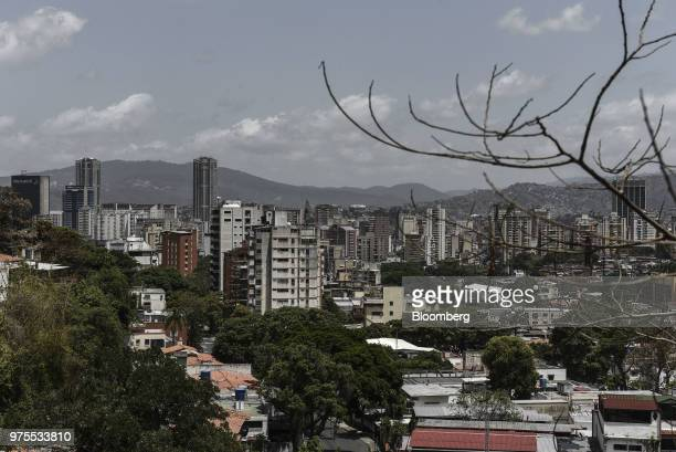 Commercial and residential buildings stand in Caracas Venezuela on Friday June 15 2018 Venezuela President Nicolas Maduro replaced part of his...