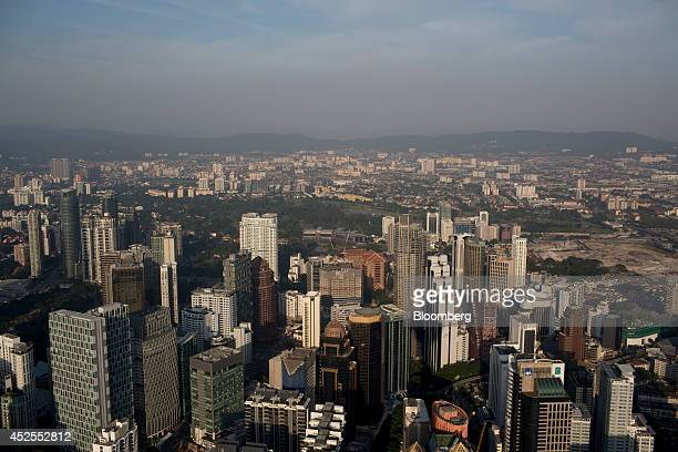 Commercial and residential buildings stand in Kuala Lumpur Malaysia on Sunday July 20 2014 Malaysian Airline System Bhd reeling from its second...