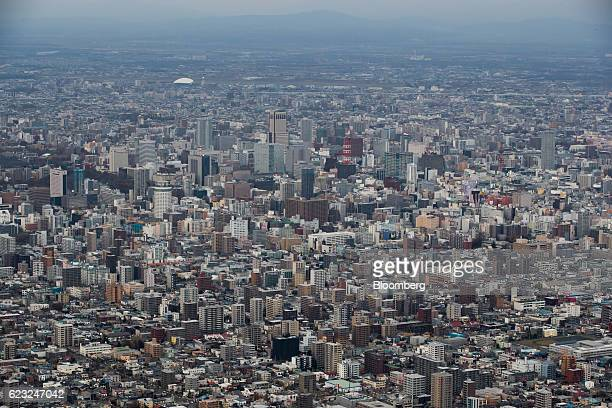 Commercial and residential buildings stand in Sapporo Hokkaido Japan on Monday Nov 14 2016 Japans economy grew more than forecast in the three months...
