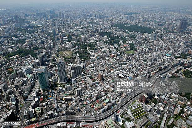 Commercial and residential buildings stand in this aerial photograph taken in Tokyo Japan on Wednesday June 24 2015 The Abe administration aims to...