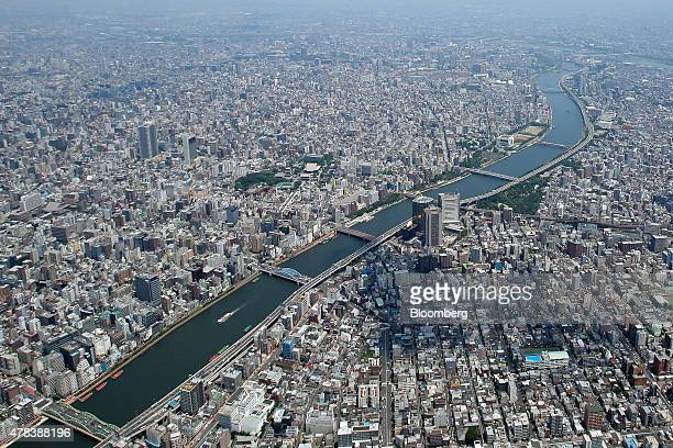 Commercial and residential buildings stand near the Sumida river in this aerial photograph taken in Tokyo Japan on Wednesday June 24 2015 The Abe...