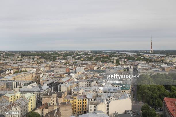Commercial and residential property sit on the city skyline as the Riga Radio and Television tower stands on the bank of the Daugava River in Riga...