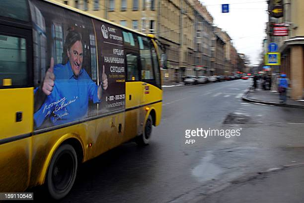 A commercial billboard on a bus shows French actor Gerard Depardieu in St Petersburg on January 8 2013 Depardieu the actor who threatened to quit his...