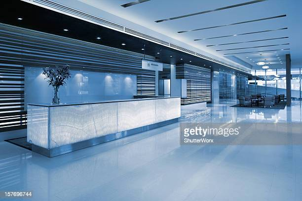 commercial building lobby reception - hotel lobby stock pictures, royalty-free photos & images