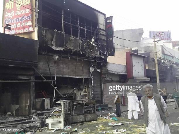 Commercial buildings gutted in fire near bypass as Jat community protests for reservation in government services on February 21 2016 in Rohtak India...