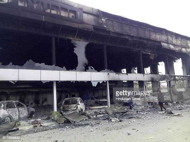 Commercial buildings gutted in fire near bypass as Jat community protests for reservation in government services, on February 21, 2016 in Rohtak,...