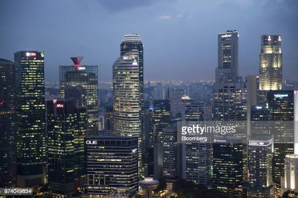 Commercial buildings in the central business district are illuminated at dusk in Singapore on Wednesday June 13 2018 Tourism as well as the consumer...