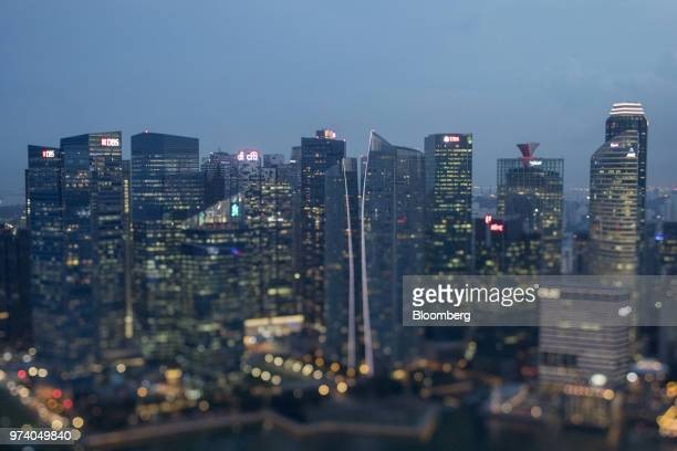Image was created using a variable planed lens Commercial buildings in the central business district are illuminated at dusk in Singapore on...