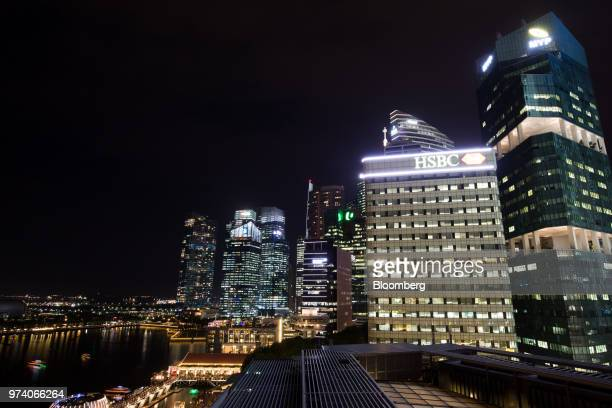 Commercial buildings in the central business district are illuminated at night in Singapore on Wednesday June 13 2018 Tourism as well as the consumer...