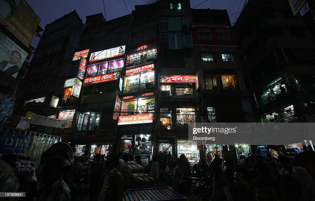 Commercial buildings stand at night in the Old Market of Dhaka, Bangladesh, on Saturday, Jan. 7, 2012. Bangladesh's central bank this month raised interest rates for the second time in four months to curb inflation that has exceeded 9 percent since the start of 2011. Photographer: Tomohiro Ohsumi/Bloomberg via Getty Images