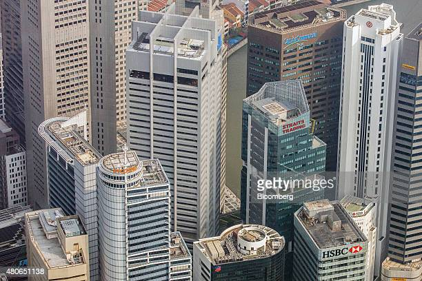 Commercial buildings stand in the central business district in this aerial photograph taken above Singapore on Thursday July 2 2015 Singapore's...