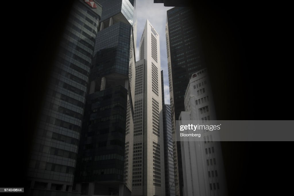 Commercial buildings stand in the central business district of Singapore, on Wednesday, June 13, 2018. Tourism as well as the consumer sector will likely see a lift thanks to the influx of international media at the recent DPRK-USA Summit, according to RHB Research Institute Singapore Pte. Photographer: Brent Lewin/Bloomberg via Getty Images