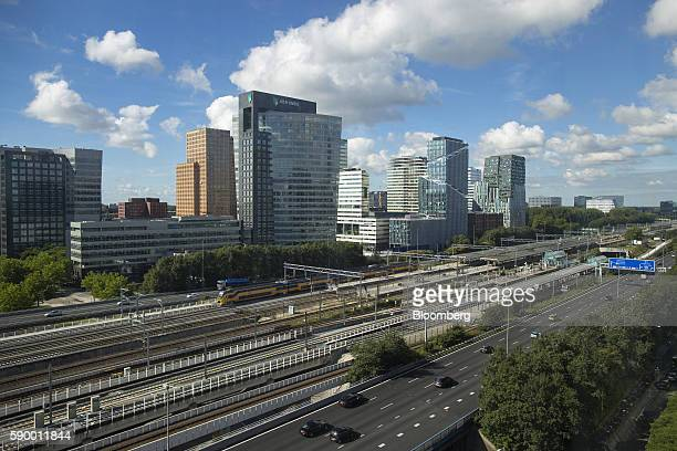 Commercial buildings stand in the Zuidas business district beyond a road highway and railway lines in Amsterdam Netherlands on Monday Aug 15 2016 The...