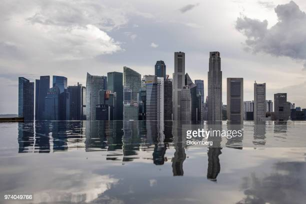 Commercial buildings standing in the central business district are reflected in a rooftop pool in Singapore on Wednesday June 13 2018 Tourism as well...