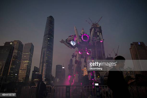 Commercial buildings surround a robot exhibit at the Guangzhou International Light Festival in the Zhujiang New Town district of Guangzhou Guangdong...