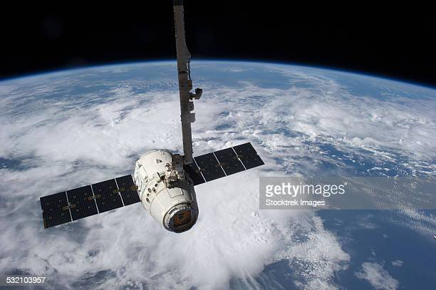 A commercial cargo spacecraft prior to being released by the Canadarm2 robotic arm.