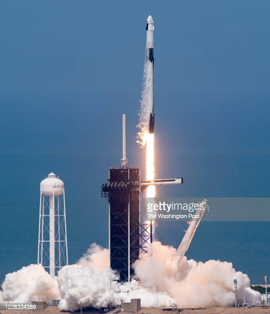Commercial crew astronauts Doug Hurley and Bob Behnken blast off from historic Launch Complex 39A aboard the SpaceX Falcon 9 rocket in the crew...