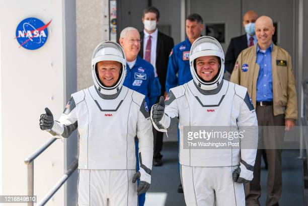 NASA commercial crew astronauts Doug Hurley and Bob Behnken walk out on their way to launch from historic Launch Complex 39A aboard the SpaceX Falcon...