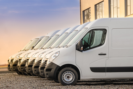 commercial delivery vans in row 1140988145