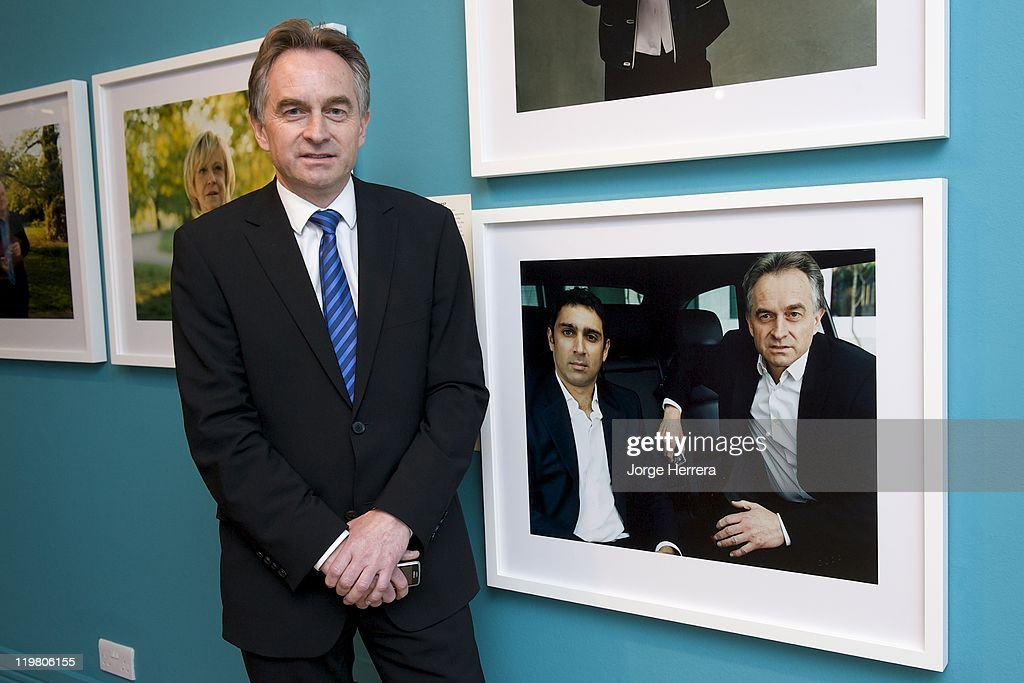 Commercial Director of the London Organising Committee for the Olympic and Paralympic Games Chris Townsend poses by his portrait during 'Road to 2012: Changing Pace,' the unveiling of new portraits of the people making London 2012 happen, at the National Portrait Gallery on July 25, 2011 in London, England.