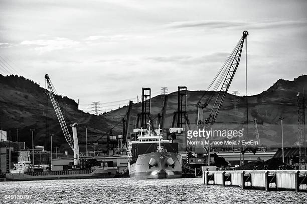 commercial dock at harbor against sky - norma crane stock pictures, royalty-free photos & images