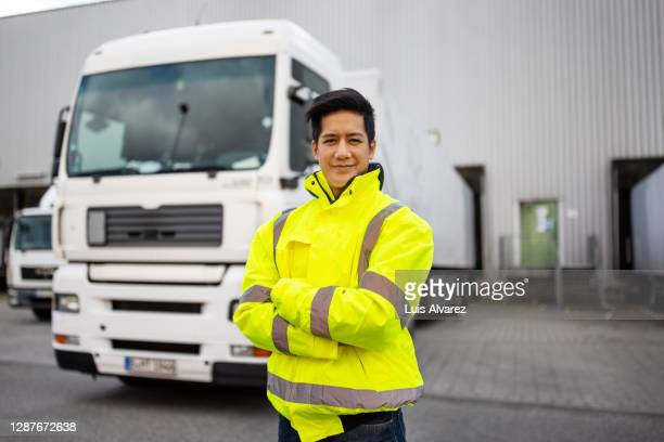 commercial dock engineer standing in front of a truck - mid adult stock pictures, royalty-free photos & images