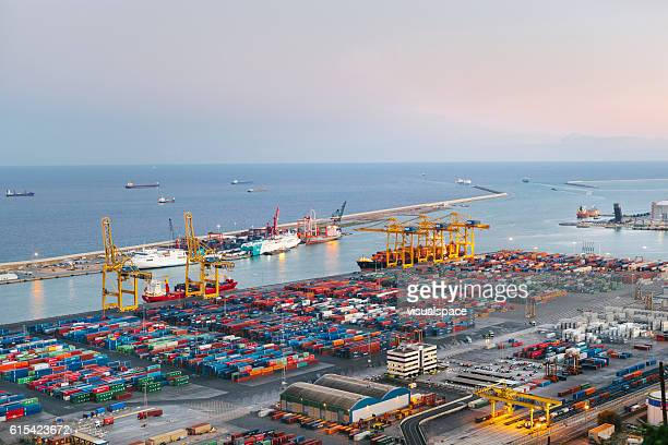 commercial dock with containers and cranes - porto marittimo foto e immagini stock