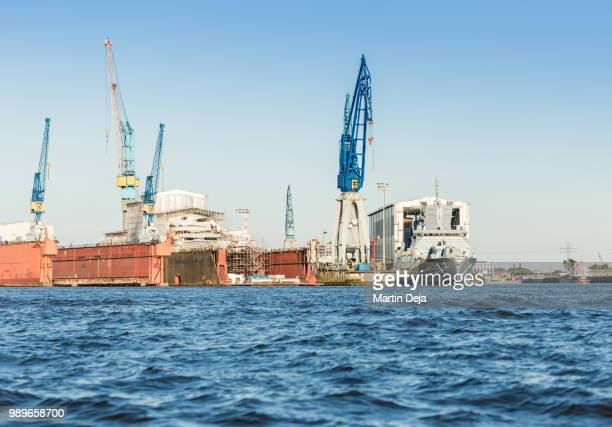 commercial docks hamburg - elbe river stock photos and pictures