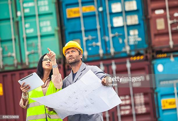 commercial docks worker and inspector at work - dock worker stock photos and pictures