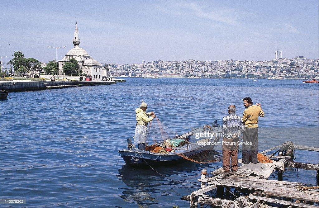Commercial fishermen with fishing nets, Sea of Marmara, Turkey.