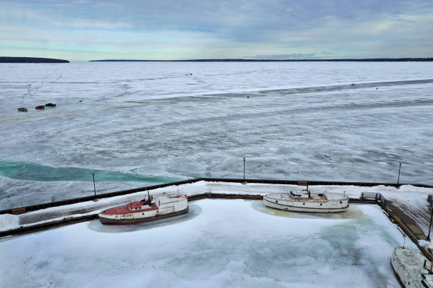 WI: Commercial Fishermen Fish Through Ice On Lake Superior