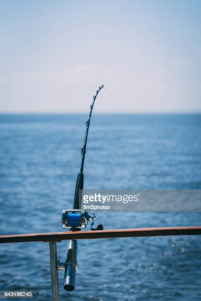 commercial fishing pole gear on a boat - deep sea fishing stock photos and pictures