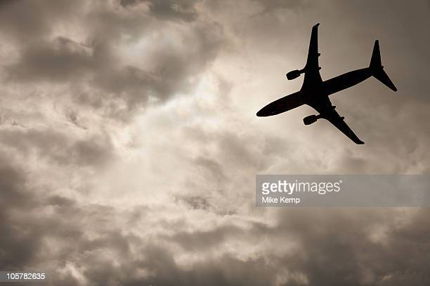 Commercial jet in cloudy sky