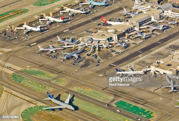 Commercial jets at Los Angeles Airport photographed from a helicopter over head.