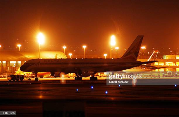 Commercial jets stand idle at John Wayne Airport after it was shut down September 11 2001 in Santa Ana California in response to terrorist air...
